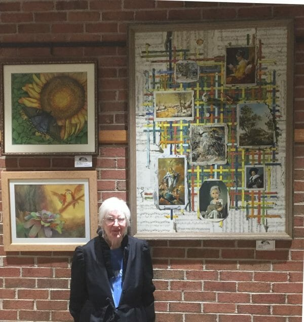 Sharon Craven Kinzer with her painting, Ribbons
