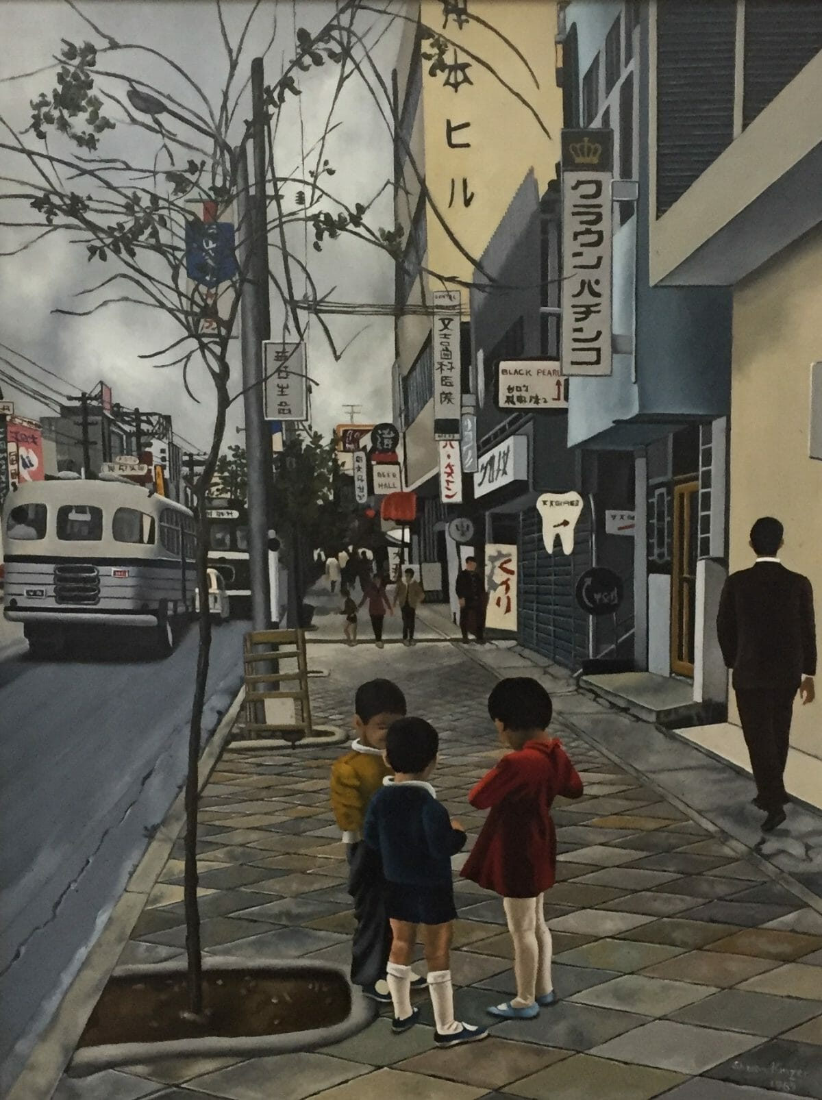 Okinawa street scene with children and a city bus.